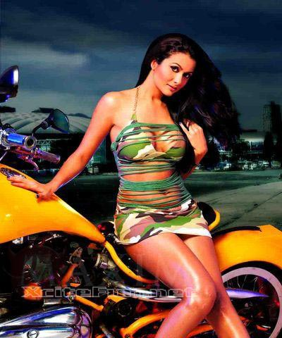 Amrita arora poses with guns in the latest issue of maxim