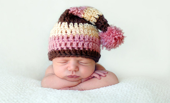 baby with funny cap