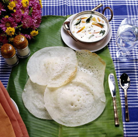 Kerala 39 s lunch items on table for Appam and chicken stew kerala cuisine