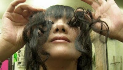 Woman with the Longest Eyelashes in the World - XciteFun.net
