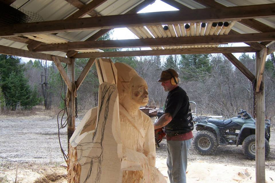 Wooden sculpture with chainsaw by mark tyoe xcitefun