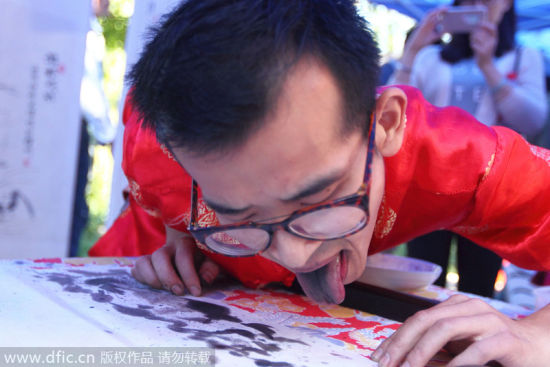 363333,xcitefun-tongue-painting-1 - Artist with a Taste for Painting Uses His Tongue as a Brush - Weird and Extreme