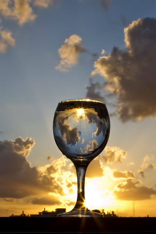 sunset photography through drinking glass