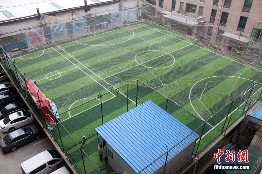 Playing Football On The Roof of Building
