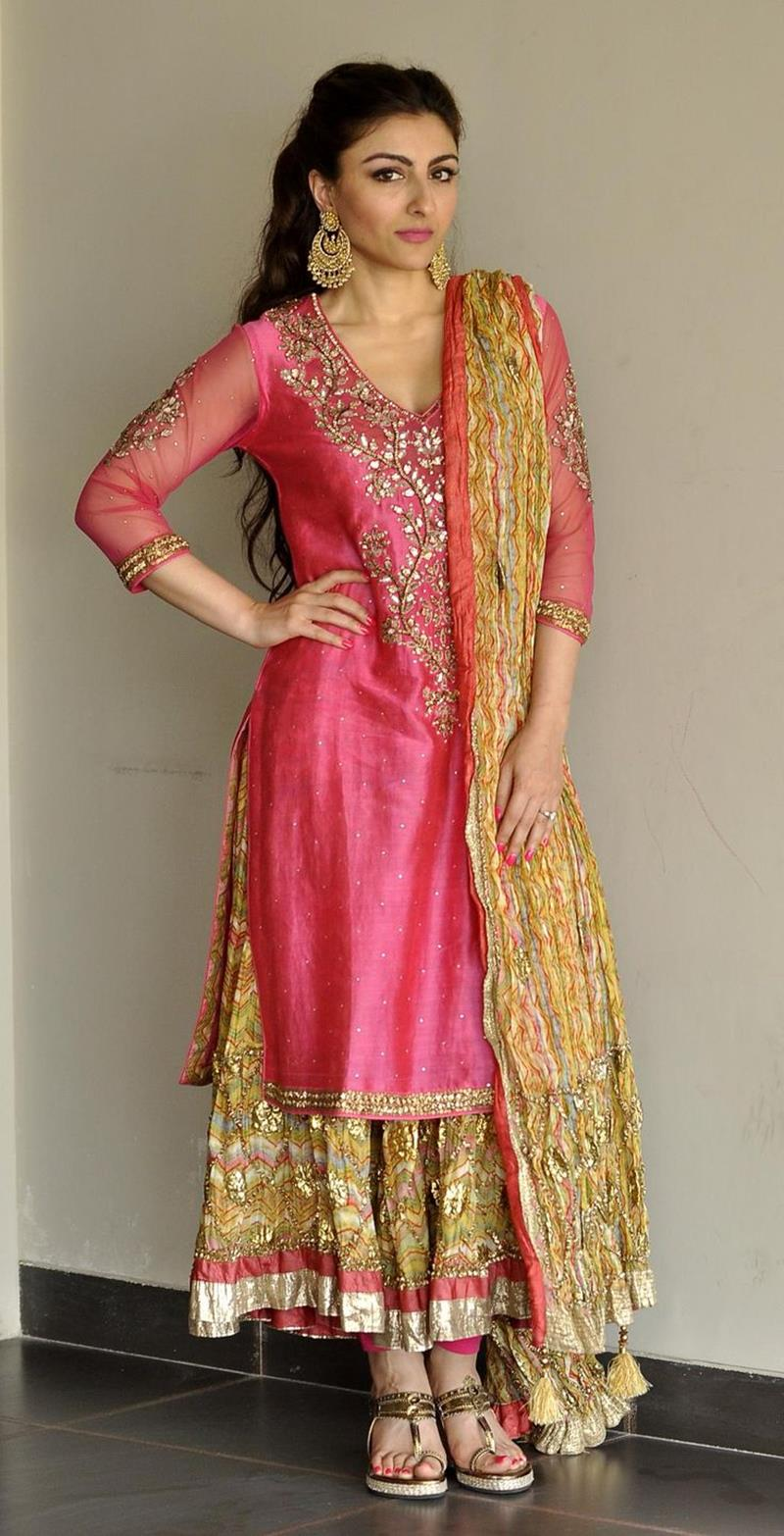 Vibrant Color Scheme And Traditional Mehndi Wear